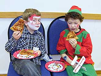 Children eating pizza with aeroplane