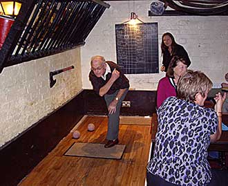 Man bowling at skittles evening