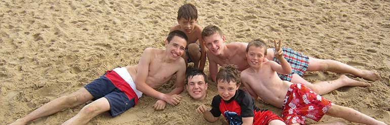6 boys playing on the beach